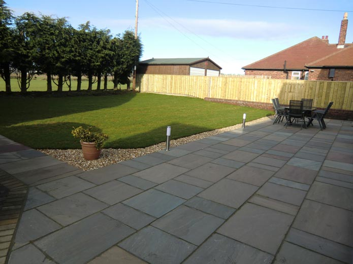 Rear garden large patio area aycliffe today for Garden ideas for patio areas