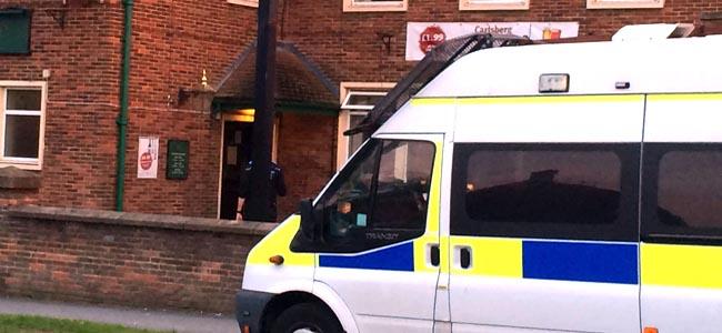 police van outside oak tree