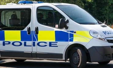 Cyclist injured following collision with police van