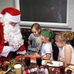 Santa hands out presents at Rof 59 in Newton Aycliffe. Pictured are 7-year-olds Maisie(right) and Summer and 8-year-old Katie(left). Picture by Stuart Boulton. Picture by Stuart Boulton.