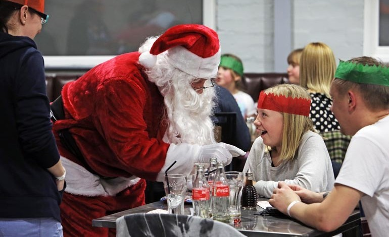 Santa lights up faces with an early visit at ROF 59