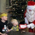 Santa with brothers 4-year-old Alfie and 8-year-old Archie Brown at Rof 59 in Newton Aycliffe. Picture by Stuart Boulton.