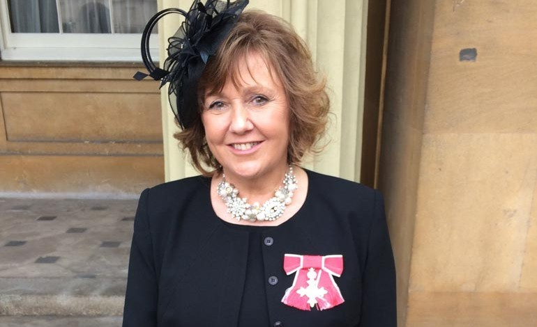 Business leader collects her MBE from the Queen