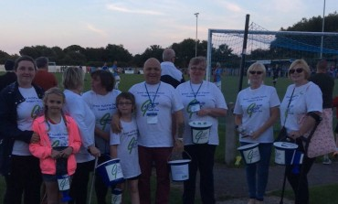 Footie Fans Dig Deep for Charity