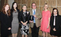 Roman celebrates Queens Award