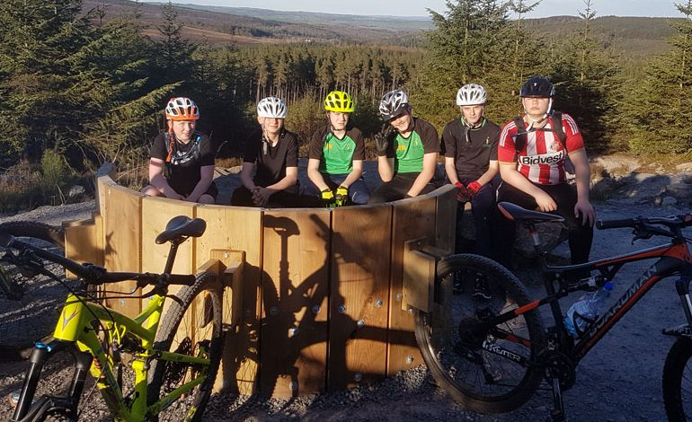 Students get on their bikes during after-school Hamsterley trips