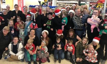 Children's Down Syndrome project serenades shoppers to say thanks to the local community