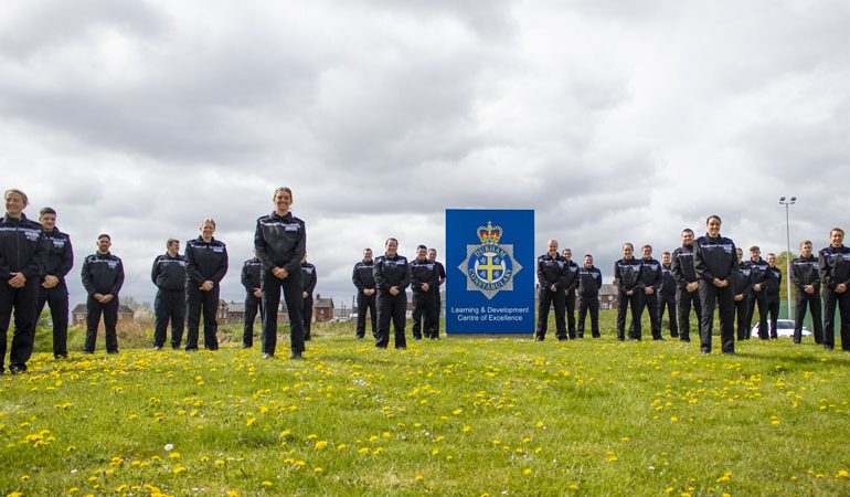 New police recruits start training – but keep their distance