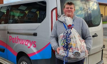 Pathways users providing food parcels for families