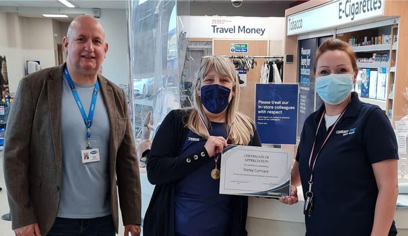 Store worker is handed inaugural Community Spirit Award