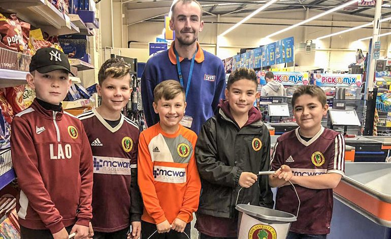 Junior footy team raise £180 from B&M bag-pack