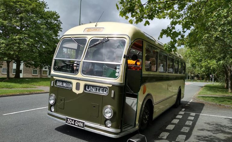 Community Association members enjoy trip out on classic bus